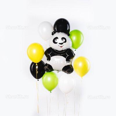 Фонтан из шаров с пандой посередине и желтыми, белыми и зелеными шарами